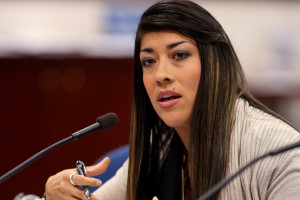 Nevada Assemblywoman Lucy Flores, D-Las Vegas, presents a measure in committee at the Legislative Building in Carson City, Nev., on Friday, May 10, 2013. Flores urged the committee to support her proposal that would provide an avenue for victims of domestic violence to get out of leases without being financially liable for the remainder of the lease. (AP Photo/Cathleen Allison)
